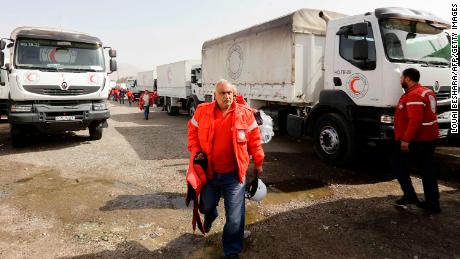 Vehicles carrying aid wait at the al-Wafideen checkpoint on the outskirts of Damascus.