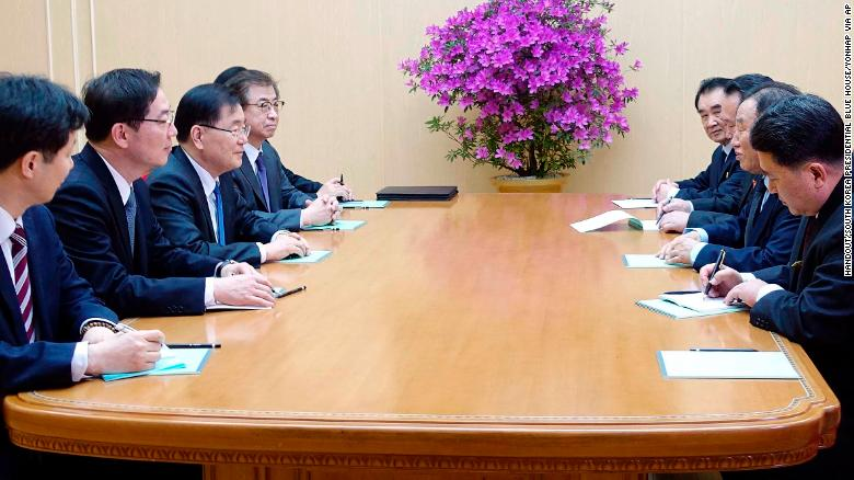 In this photo provided by the South Korean President's office on Monday, South Korean national security director Chung Eui-yong, third from left, meets with North Korean vice chairman of the ruling Workers' Party Central Committee Kim Yong Chol, second from right, in Pyongyang.