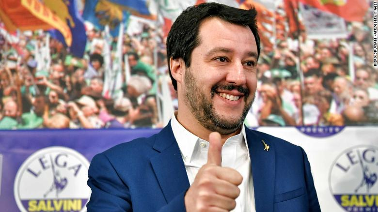 Salvini gives a thumb's up at League headquarters in Milan on Monday morning.