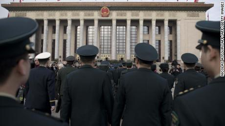 Military delegates arrive for the opening session of the National People's Congress, China's legislature, in Beijing's Great Hall of the People on March 5, 2018. China's rubber-stamp parliament opens a major annual session set to expand President Xi Jinping's considerable power and clear him a path towards lifelong rule. / AFP PHOTO / NICOLAS ASFOURI        (Photo credit should read NICOLAS ASFOURI/AFP/Getty Images)