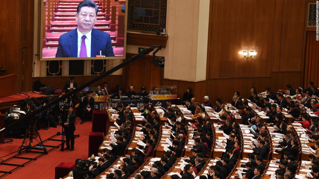 A live image of Chinese President Xi Jinping is seen on a screen above delegates as they listen to Premier Li Keqiang's speech during the opening session of the National People's Congress in the Great Hall of the People in Beijing on March 5, 2018. China's rubber-stamp parliament opens a major annual session set to expand President Xi Jinping's considerable power and clear him a path towards lifelong rule. / AFP PHOTO / GREG BAKER        (Photo credit should read GREG BAKER/AFP/Getty Images)