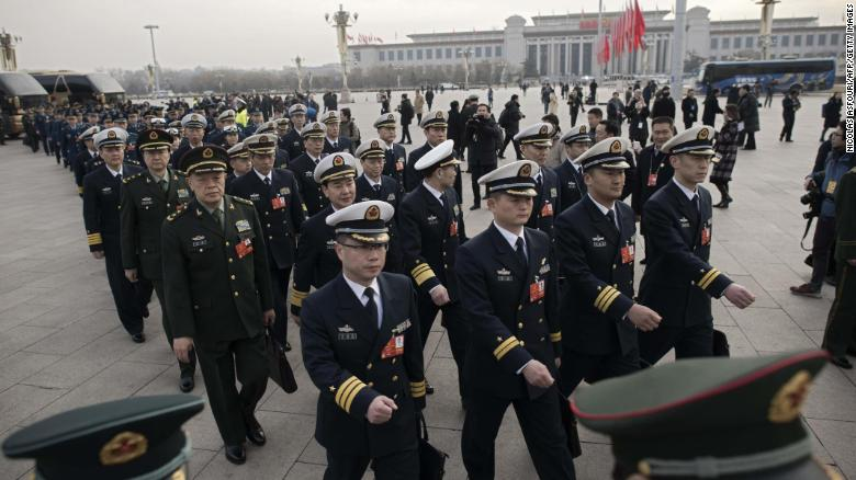 China beefs up military, looks to end presidential term limits