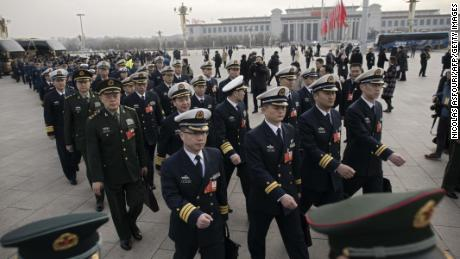 Military delegates arrive for the opening session of the National People's Congress, China's legislature, in Beijing's Great Hall of the People on March 5, 2018.