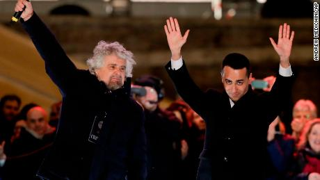 Five Star Movement leader Luigi di Maio (R) waves to supporters at a rally with party founder Beppe Grillo (L) in Rome on Friday.