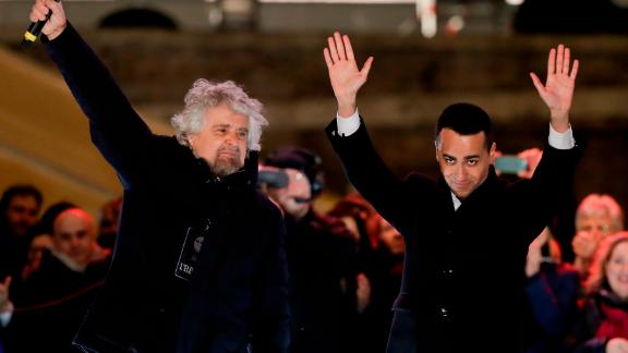 M5S leader Luigi Di Maio (R) and party founder Beppe Grillo (L) attend the party
