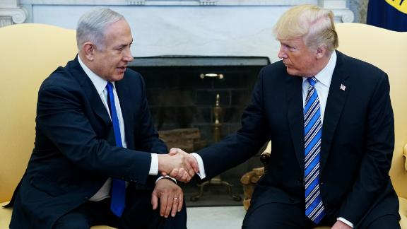 US President Donald Trump shakes hands with Israel