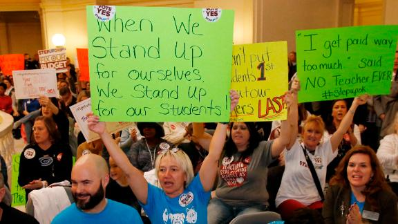 Oklahoma school personnel cheer February 12 in support of a proposed teacher pay raise at the state capitol.