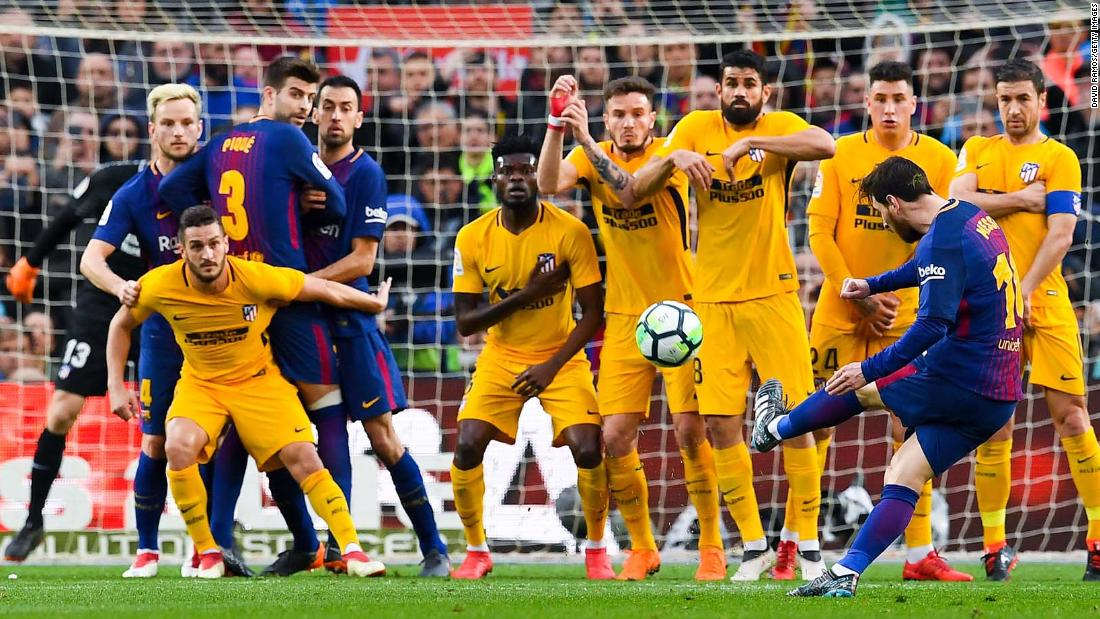 "Barcelona star Lionel Messi curves a free kick around a wall to score the only goal in a Spanish league match against Atletico Madrid on Sunday, March 4. It was <a href=""http://bleacherreport.com/articles/2762594-lionel-messis-600th-goal-lifts-barcelona-to-1-0-la-liga-win-vs-atletico-madrid"" target=""_blank"">Messi's 600th goal</a> for club and country."