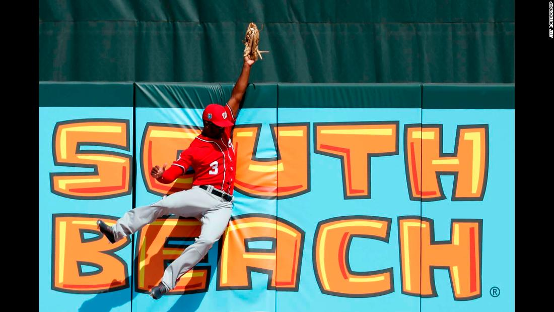Washington Nationals center fielder Michael A. Taylor leaps at the wall to make a catch during a spring-training game in Jupiter, Florida, on Wednesday, February 28.
