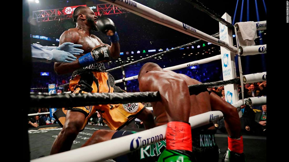Deontay Wilder celebrates after knocking down Luis Ortiz during the sixth round of their heavyweight title bout on Saturday, March 3. Ortiz got up, but Wilder stopped him in the 10th round to retain his WBC title.