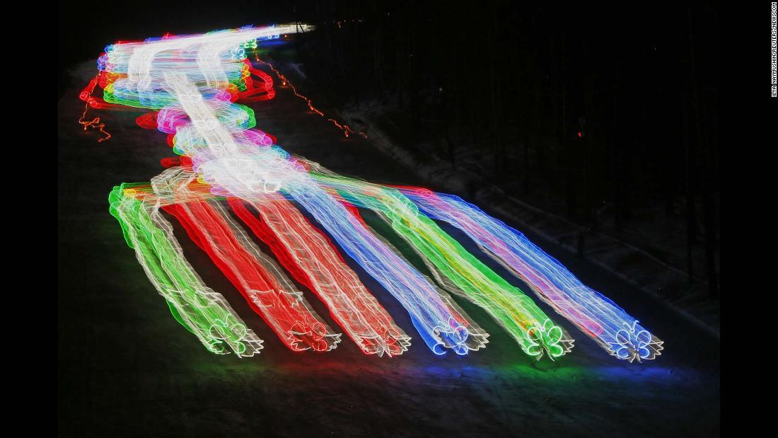 In this long-exposure photo, members of a skiing school wear lighted costumes as they make their way down a slope in Krasnoyarsk, Russia, on Saturday, March 3.