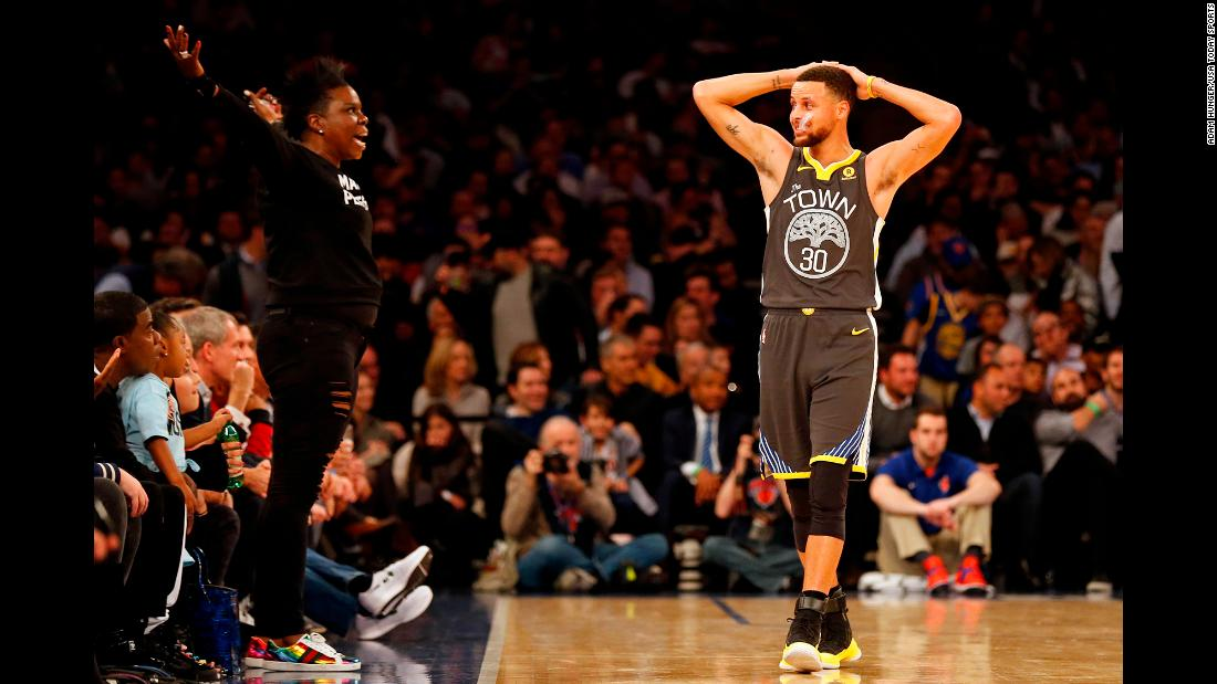 Golden State guard Stephen Curry looks at comedian Leslie Jones as she reacts during an NBA game in New York on Monday, February 26.