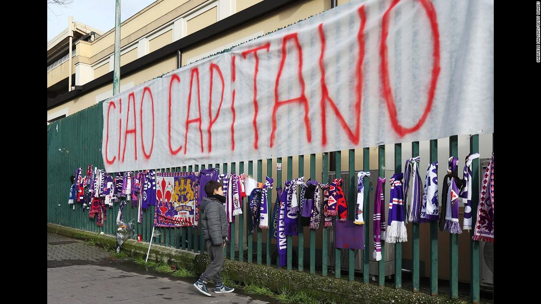 "A young fan visits a memorial for Davide Astori outside a soccer stadium in Florence, Italy, on Sunday, March 4. Astori, the 31-year-old captain of Fiorentina,<a href=""https://www.cnn.com/2018/03/04/football/italian-footballer-fiorentina-davide-astori-dies/index.html"" target=""_blank""> was found dead</a> on Sunday morning ahead of his team's match against Udinese. The club said he died of a sudden illness."
