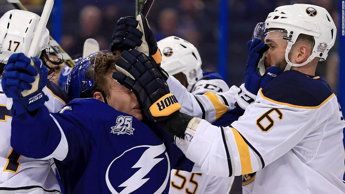 "Buffalo's Marco Scandella, right, exchanges a ""face wash"" with Tampa Bay's Yanni Gourde during an NHL game on Wednesday, February 28."