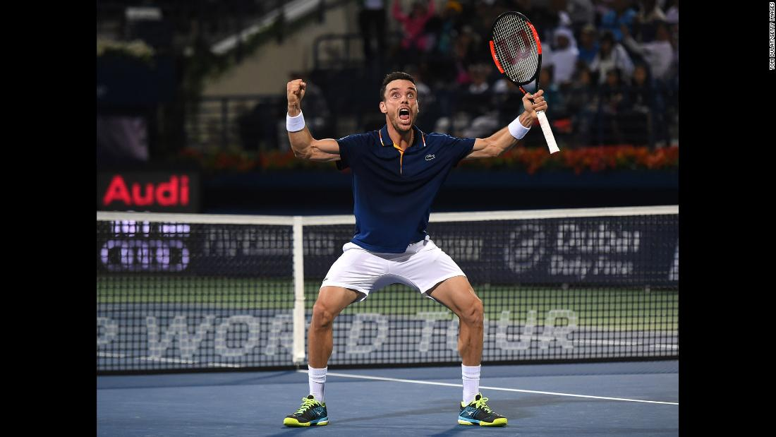 Roberto Bautista Agut celebrates after winning the final of the Dubai Tennis Championships on Saturday, March 3.