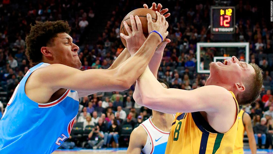 Sacramento's Justin Jackson, left, and Utah's Jonas Jerebko battle for the ball during an NBA game in Sacramento, California, on Saturday, March 3.
