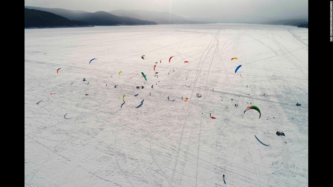 Kite boarders and kite skiers compete on the ice-covered Yenisei River outside Krasnoyarsk, Russia, on Sunday, March 4.