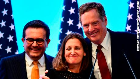 "(L-R) Mexican Economy Minister Idelfonso Guajardo, Canadian Minister of Foreign Affairs, Chrystia Freeland and US Trade Representative Robert Lighthizer pose for pictures before giving a message to the media during the seventh round of NAFTA (North American Free Trade Agreement) talks in Mexico City, on March 5, 2018. US President Donald Trump said he would not back down on the tariffs, nor offer exclusions to NAFTA partners Canada and Mexico unless he gets a ""fair"" deal in the current negotiations to revamp the 1994 trade agreement. / AFP PHOTO / Ronaldo SCHEMIDT        (Photo credit should read RONALDO SCHEMIDT/AFP/Getty Images)"