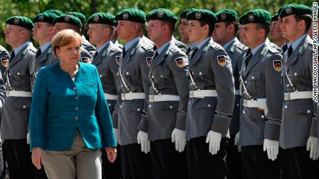 German Chancellor Angela Merkel greets the soldiers of the military honour guard ahead of the welcoming ceremony for Estonia's Prime Minister Jueri Ratas at the Chancellery in Berlin on June 15, 2017.