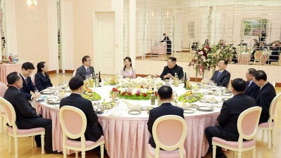 North Korean leader Kim Jong Un (center right) sits with a visiting South Korean delegation in Pyongyang and other high-level North Koreans.
