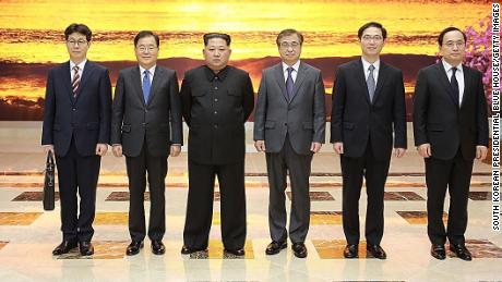 In this handout image provided by the South Korean Presidential Blue House, Chung Eui-yong (second from the left), head of the presidential National Security Office pose with North Korean leader Kim Jong Un (third from the left) on Monday in Pyongyang, North Korea.