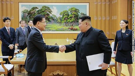 PYONGYANG, NORTH KOREA - MARCH 05: In this handout image provided by the South Korean Presidential Blue House, Chung Eui-Yong (L), head of the presidential National Security Office shakes hands with North Korean leader Kim Jong-Un (R) during their meeting on March 5, 2018 in Pyongyang, North Korea. South Korean envoys are to visit North Korea for two days to discuss issues. (Photo by South Korean Presidential Blue House via Getty Images)