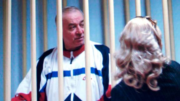 FILE - In this Wednesday, Aug. 9, 2006 file photo, Sergei Skripal speaks to his lawyer from behind bars seen on a screen of a monitor outside a courtroom in Moscow. It has been reported on Monday, March 5, 2018 by the British media that Skripal is in critical condition after exposure to