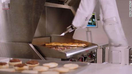 Burger-flipping robot debuts at restaurant - CNN Video