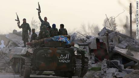 Dozens are evacuated from Eastern Ghouta as rebels promise to continue their fight
