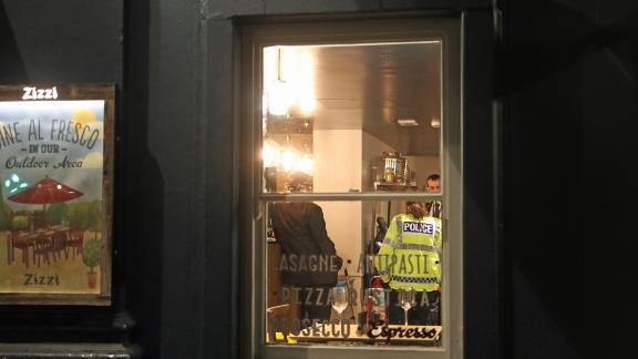Police inside a Zizzi restaurant in Castle Street, Salisbury.