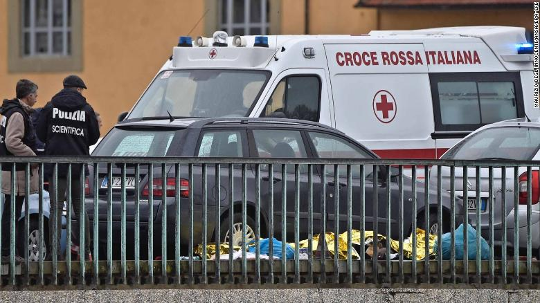 Police and rescuers at the site of the shooting in Florence on Monday.