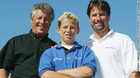 VANCOUVER- July 26: (Left to Right) Mario Andretti, his grandson Marco and his son Michael, three generations of American racing, on the weekend of Michael's 300th CART start at the Molson Indy Vancouver, round 10 of the CART (Championship Auto Racing Teams) FedEx Championship Series on July 26, 2002 at the Concord Pacific Place in Vancouver, Canada.(Photo by Robert Laberge/Getty Images).