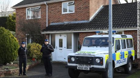 Police officers stand outside the home of  Sergei Skripal after a man and woman were found unconscious in Salisbury town centre two days previously, on March 6, 2018 in Salisbury, England.