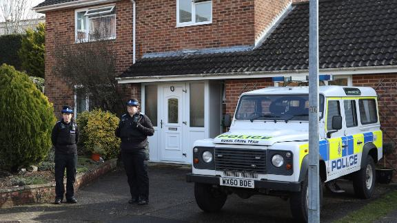 Police officers stand outside the home of former Russian spy Sergei Skripal following his alleged poisoning.