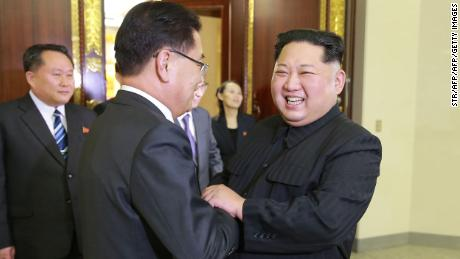 North Korean leader Kim Jong Un (right) shaking hands with South Korean national security chief Chung Eui-yong. In between them is Kim's sister, Kim Yo Jong.