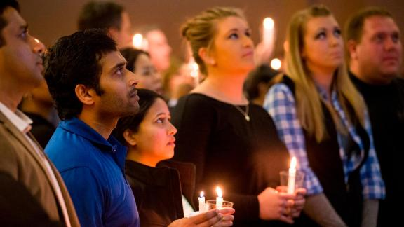 Shooting victim Alok Madasani, second from left, attends a prayer vigil in February 2017.