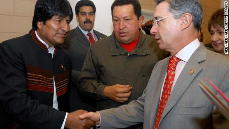 Handout picture given by Colombian presidential office showing Colombia's President Alvaro Uribe (R) and Bolivia's President Evo Morales while they shake hands next to Venezuela's President Hugo Chavez(C) during a meeting in the framework of the Fifth Summit of the Americas in Port of Spain on April 19, 2009. PHOTO/PRESIDENCY-Cesar CARRION (Photo credit should read CESAR CARRION/AFP/Getty Images)