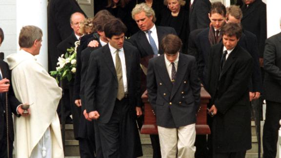 Family members carry a casket with the body of Michael Kennedy following a memorial service in 1997.