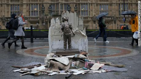 A life-size statue of a child is pictured outside of the Houses of Parliament on Wednesday as part of a protest by the charity Save The Children against the visit by Crown Prince Mohammed bin Salman.