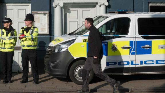 Police officers outside the Zizzi restaurant in Salisbury which has been closed following the incident.