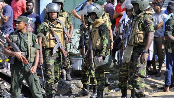 Sri Lankan police commandos patrol the streets of Pallekele, a suburb of Kandy, on March 6, 2018.