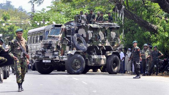 Sri Lankan police commandos on the streets of Pallekele, a suburb of Kandy, on March 6, 2018.