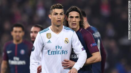 TOPSHOT - Real Madrid's Portuguese forward Cristiano Ronaldo (L) and Paris Saint-Germain's Uruguayan forward Edinson Cavani (R) react  during the UEFA Champions League round of 16 second leg football match between Paris Saint-Germain (PSG) and Real Madrid on March 6, 2018, at the Parc des Princes stadium in Paris. / AFP PHOTO / FRANCK FIFE        (Photo credit should read FRANCK FIFE/AFP/Getty Images)