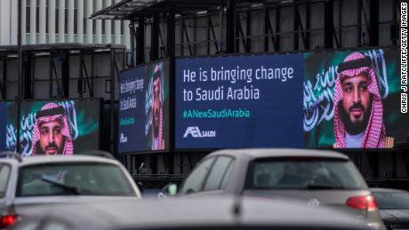 Electronic billboards show adverts for Saudi Crown Prince Mohammed bin Salman on London on Wednesday.