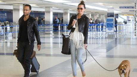 John Legend and Chrissy Teigen are seen at Los Angeles International Airport on February 16, 2013 in Los Angeles, California.