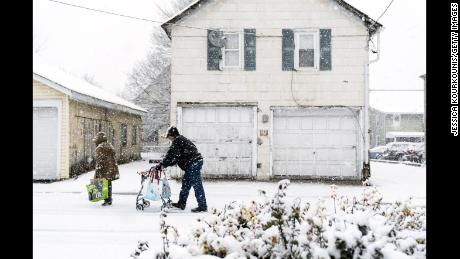 QUATKERTOWN, PA - MARCH 07:  Pedestrians walk through snow on March 7, 2018 in Quakertown, Pennsylvania, This is the second nor'easter to hit the Northeast within a week and is expected to bring heavy snowfall and winds, raising fears of another round of electrical outages.  (Photo by Jessica Kourkounis/Getty Images)