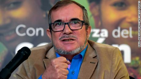 "Rodrigo Londono Echeverri, known as ""Timochenko"", the presidential candidate for the Common Alternative Revolutionary Force (FARC) party, speaks during a press conference in Bogota, on February 28, 2018. Londono delivered an S.O.S. message to save the pact of peace in the country, after he had to suspend his campaigns for political office, citing a lack of security safeguards. / AFP PHOTO / Raul ARBOLEDA        (Photo credit should read RAUL ARBOLEDA/AFP/Getty Images)"