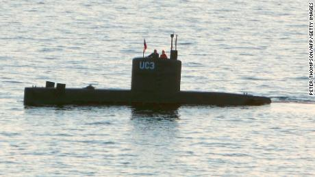 A woman alleged to be Kim Wall stands next to a man in the tower of the private submarine UC3 Nautilus on August 10 in Copenhagen Harbor.