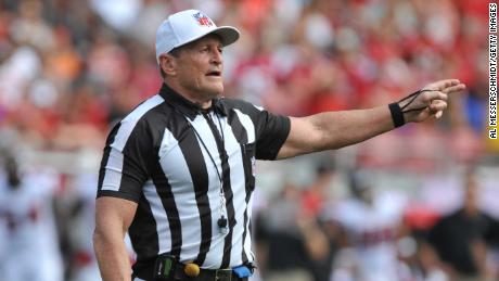 Ed Hochuli is known for his muscular physique and explanation of penalties.