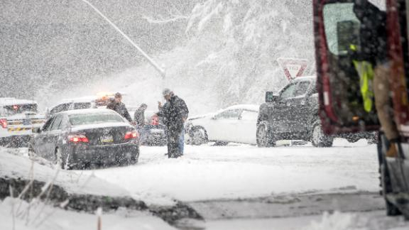 PHILADELPHIA, PA - MARCH 07: Pennsylvania State Troopers handle a car accident caused by winter weather on March 7, 2018 along the Pennsylvania Turnpike in Philadelphia, Pennsylvania, This is the second nor'easter to hit the Northeast within a week and is expected to bring heavy snowfall and winds, raising fears of another round of electrical outages.  (Photo by Jessica Kourkounis/Getty Images)